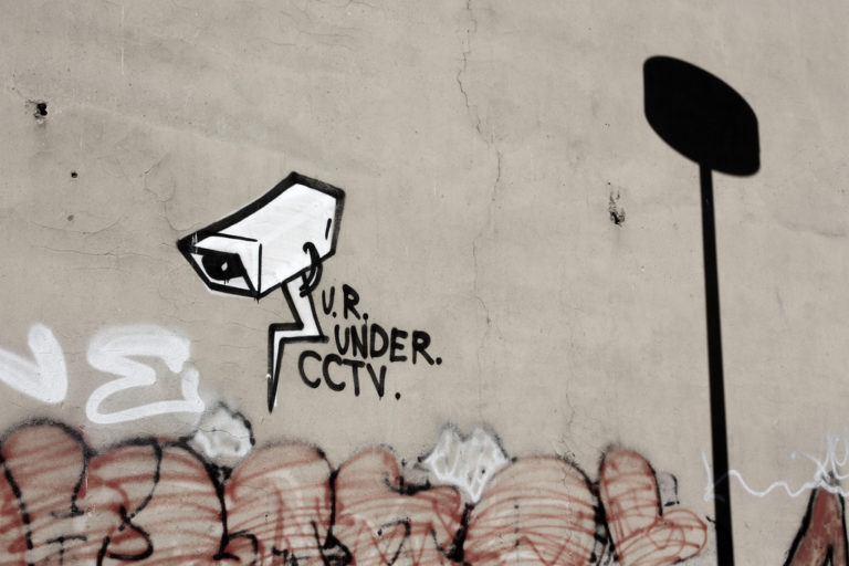 cctv street art on wall